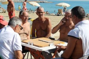 dominoes on beach