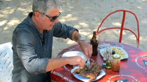 Anthony Bourdain enjoying peri peri chicken in Mozambique