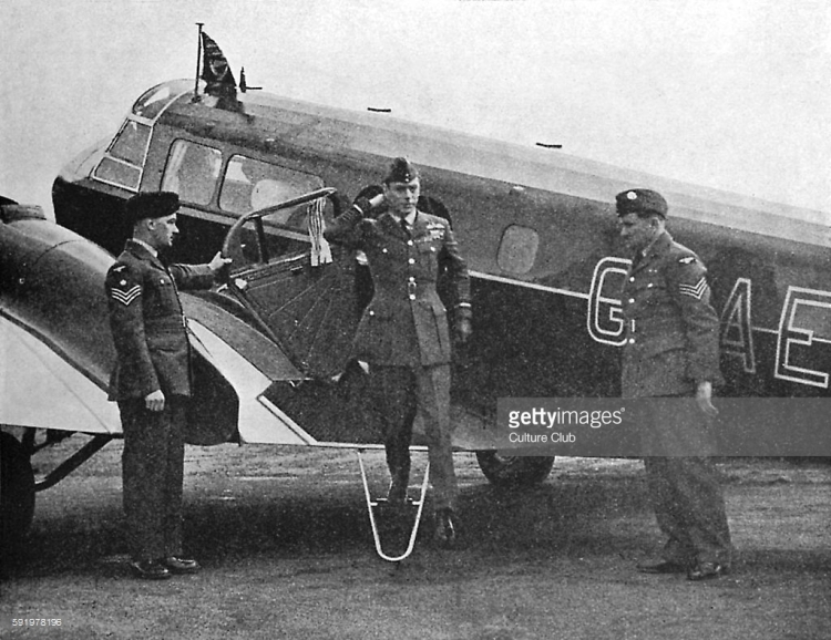 WW2 - King George VI disembarking from a plane at an R.A.F station.